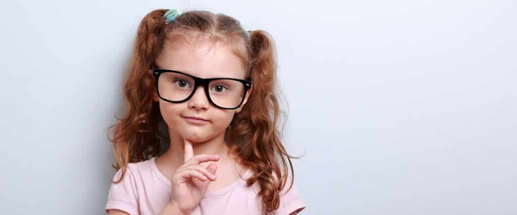 little girl in glasses who will take an istation test