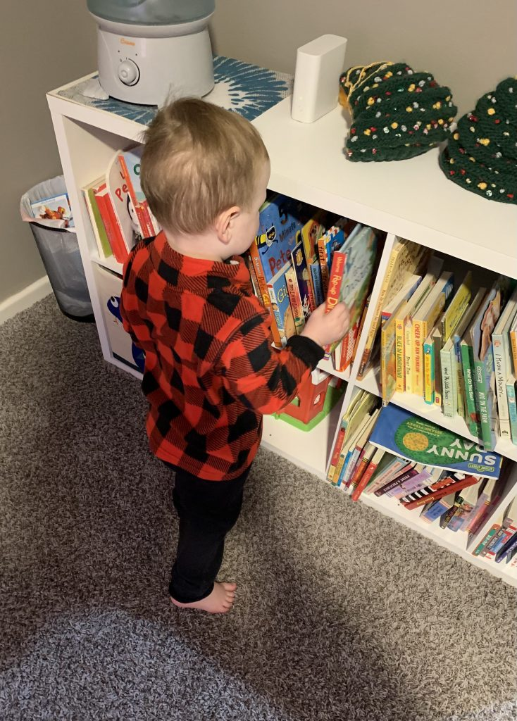 putting away messy books and toys