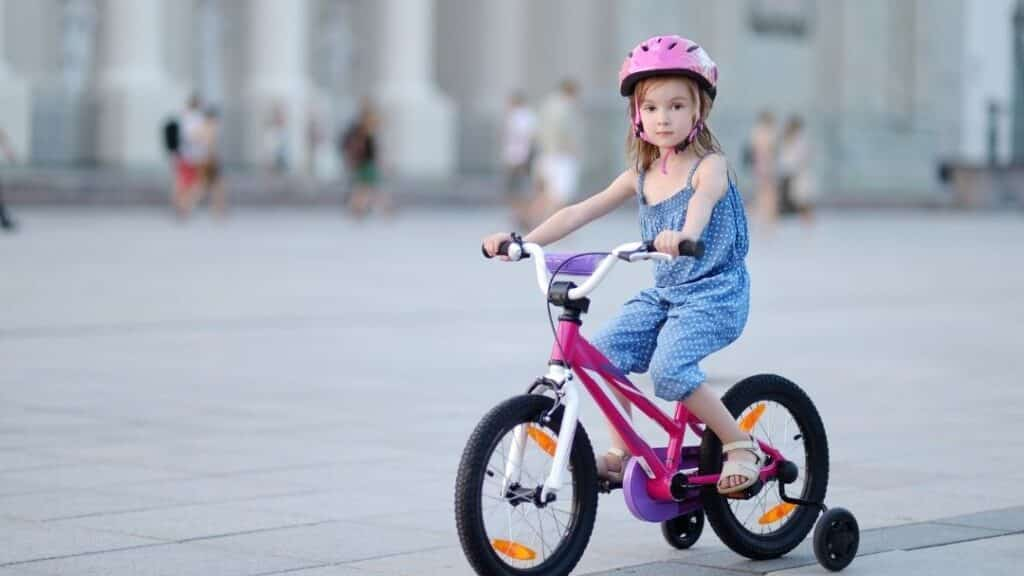 teaching your child to ride a bike - pink bicycle
