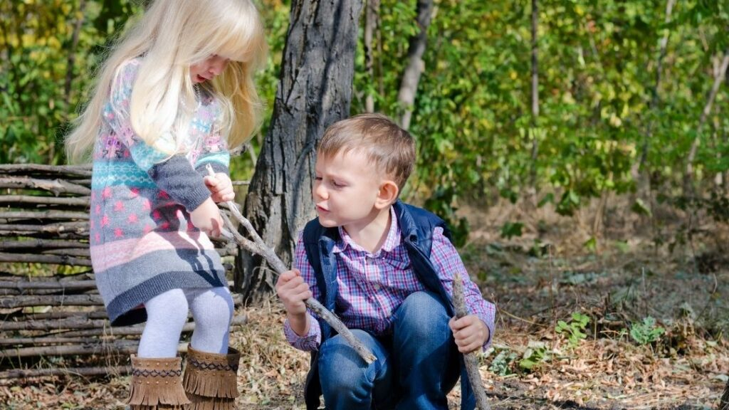 siblings fighting at a campground over a stick