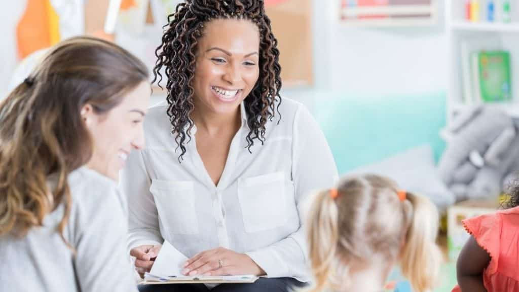 teacher, mom and little girl meeting for a parent teacher conference