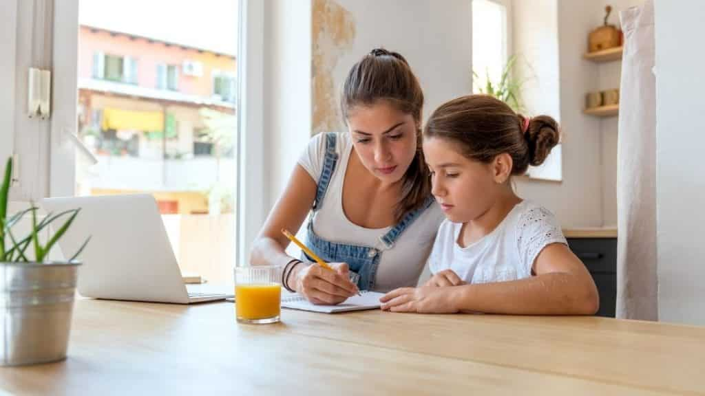 mother and daughter doing too much homework together