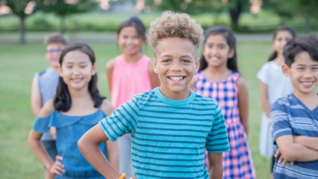 a group of happy, confident kids on the playground at school