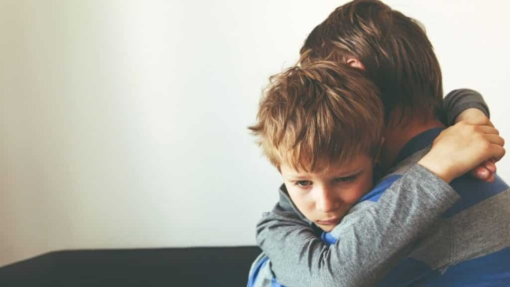 Father and son having a hug - little boy is sad