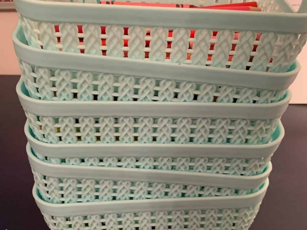 stack of mint colored baskets for crayon storage