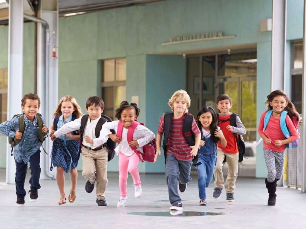 lots of kids running from the school