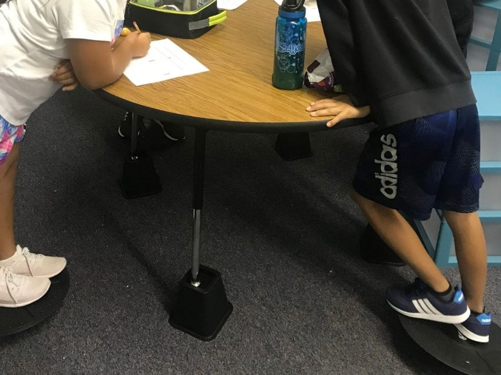 flexible seating classroom management - table on risers with swivel boards
