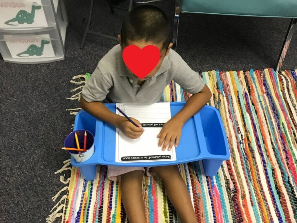 flexible seating classroom management - boy using a lap desk properly