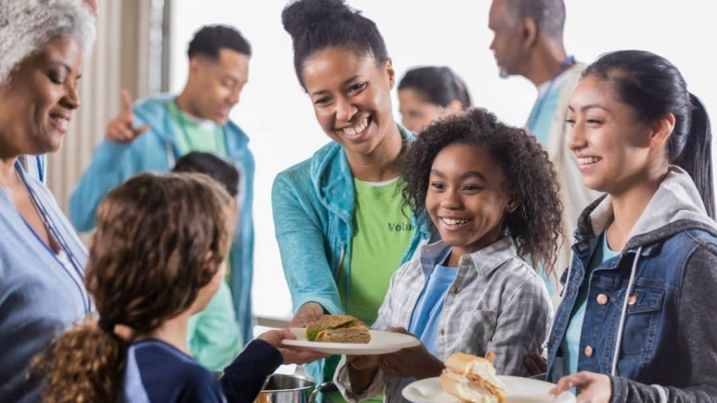 family night ideas - picture of girl serving at a soup kitchen