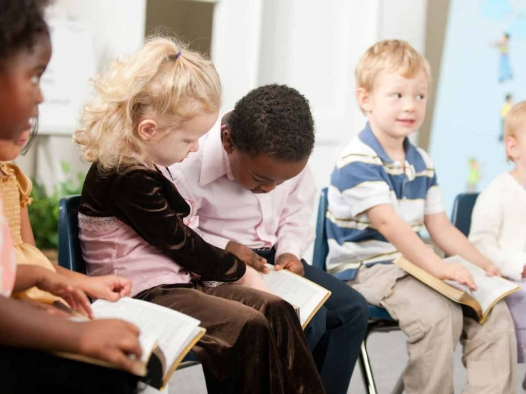 scripture for children's behavior - group of Sunday School kids reading