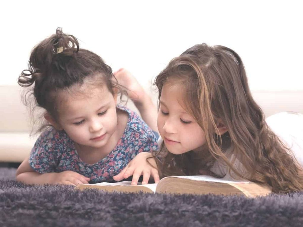 two little girls learning scripture for children's behavior