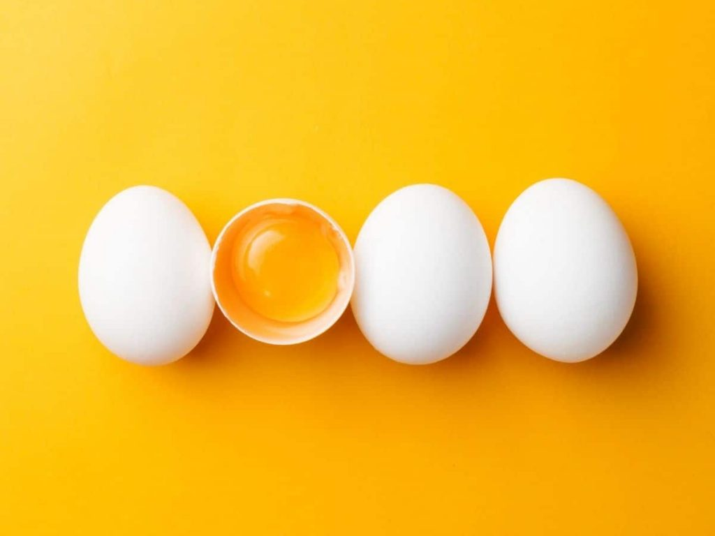 picture of eggs on a yellow background - an egg is an object lesson for the Trinity