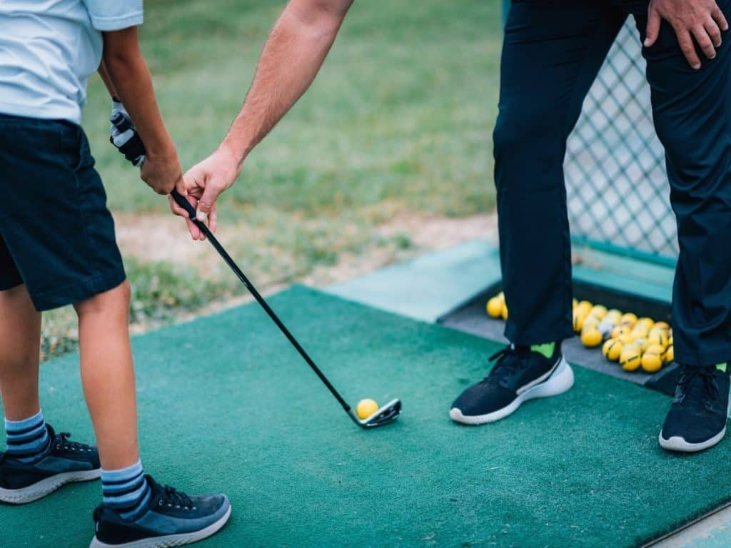 5th grade graduation gifts picture of boy taking golf lessons