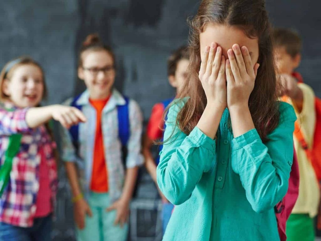 little girl being bullied in the classroom