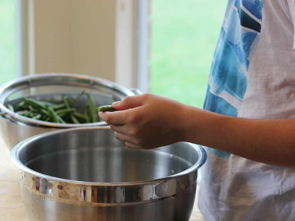 kid learning to cook dinner for self confidence