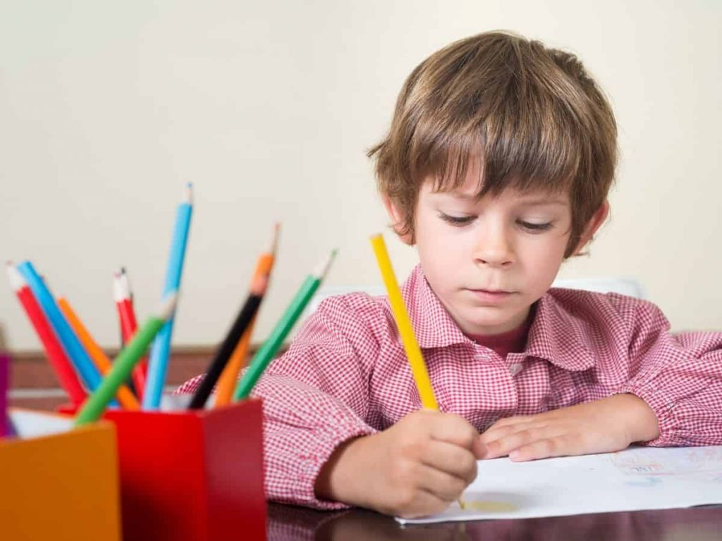 child falling behind in school doing homework with a yellow colored pencil