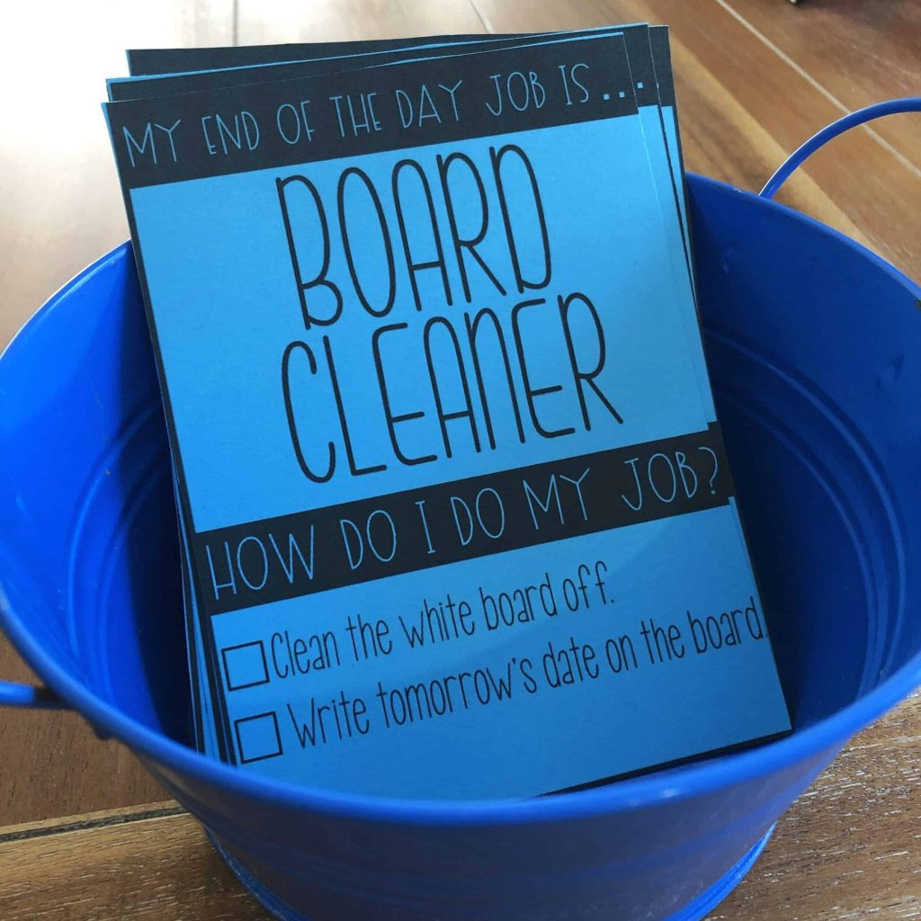 classroom job cards - blue cards with directions in a bucket