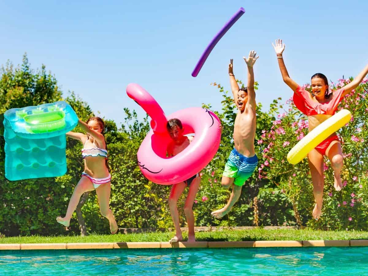 kids jumping into the swimming pool and following summer rules