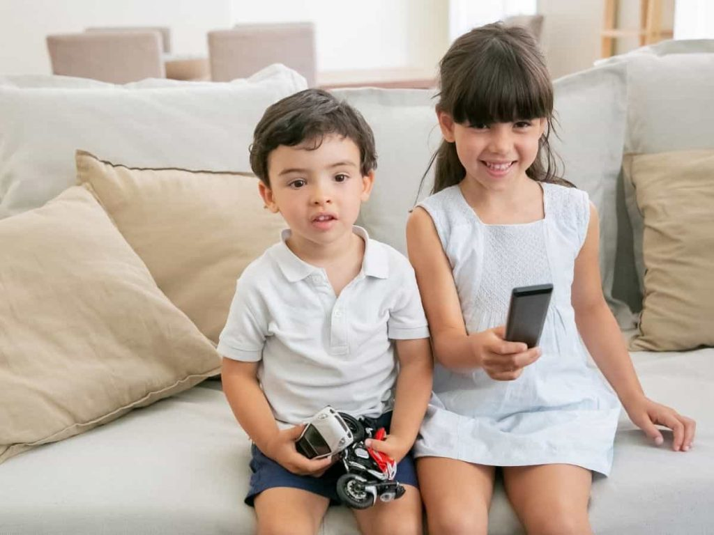 two kids watching tv following the summer rules