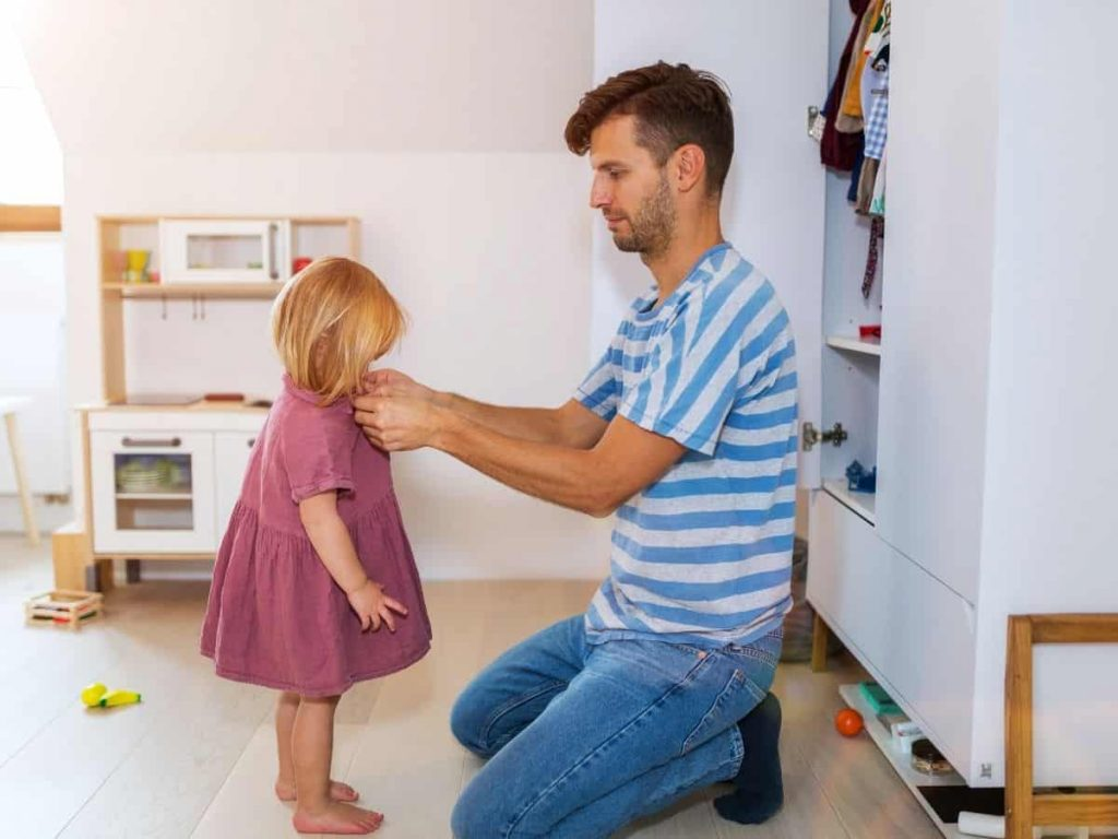toddler getting dressed with a visual schedule