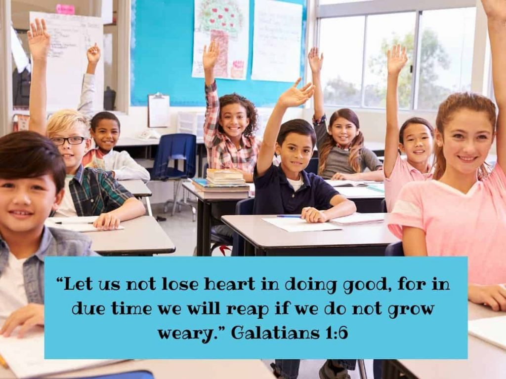 bible verses for teachers - hands up in the classroom