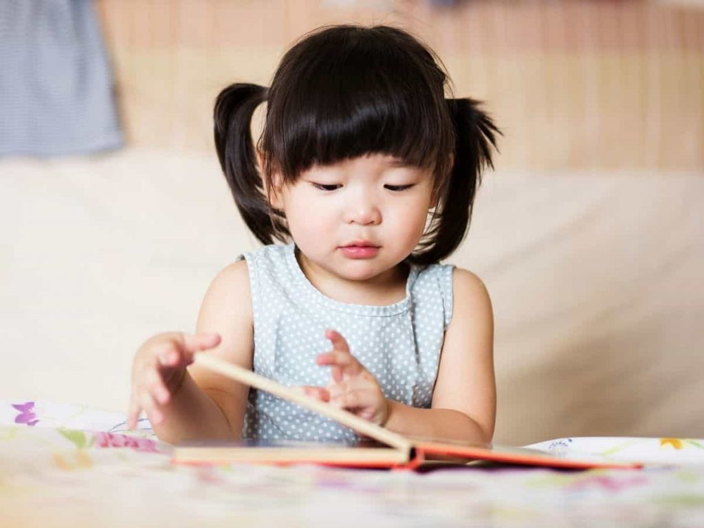 child reading a book - linguistic intelligence