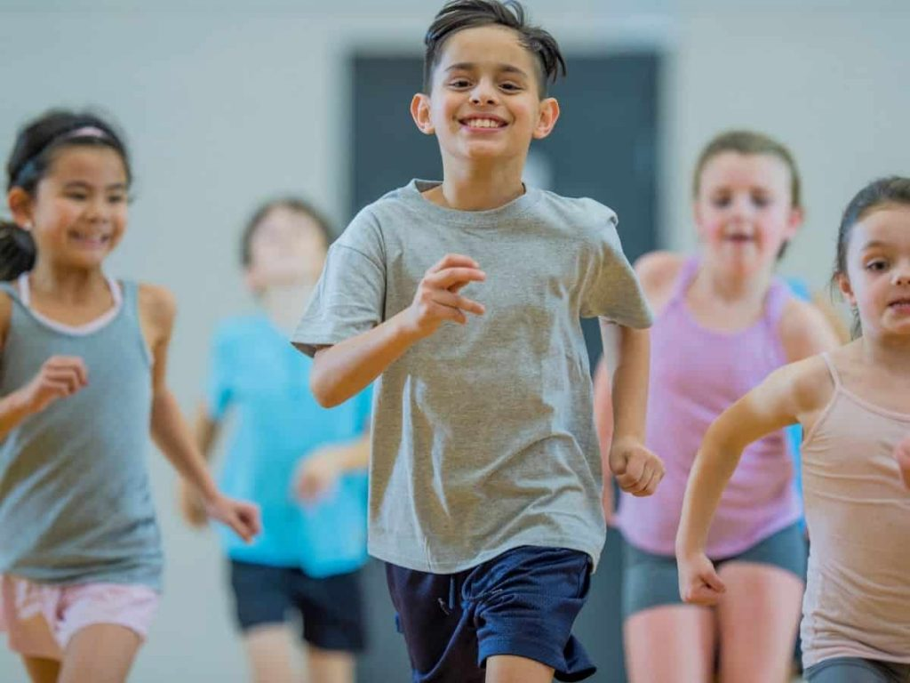bodily kinesthetic intelligence is child's strength - boy in PE