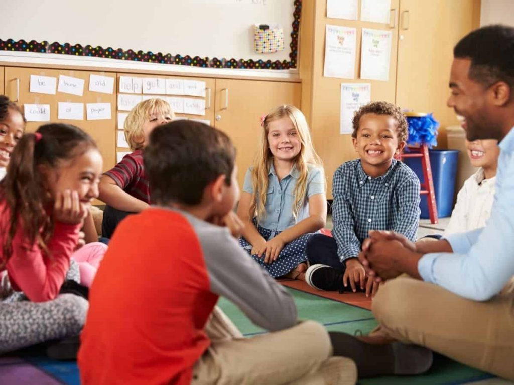 elementary school restorative circle with smiling kids