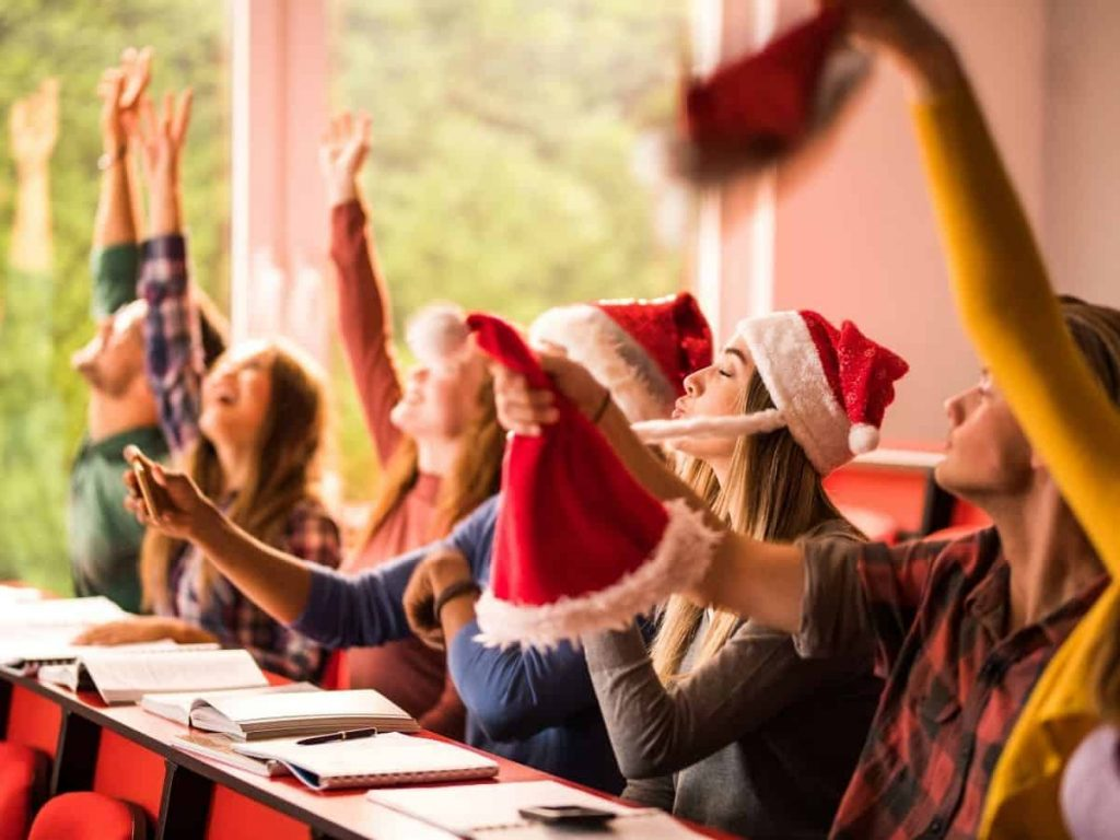 students wearing santa hats in the classroom